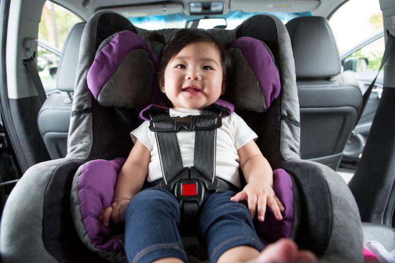 Baby buckled into auto car seat