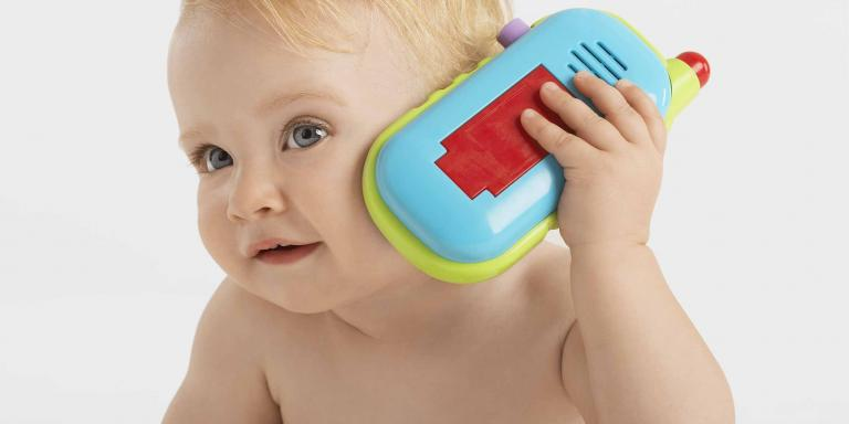 Baby holding toy phone